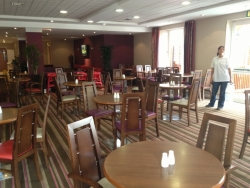 Hotel dining area ready for the next sitting with fresh clean carpets